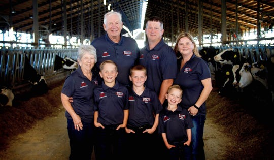 Three generations of the Peterson family include Judy, Arne, John and Jessica, and Sam, Isaac and Matthew.