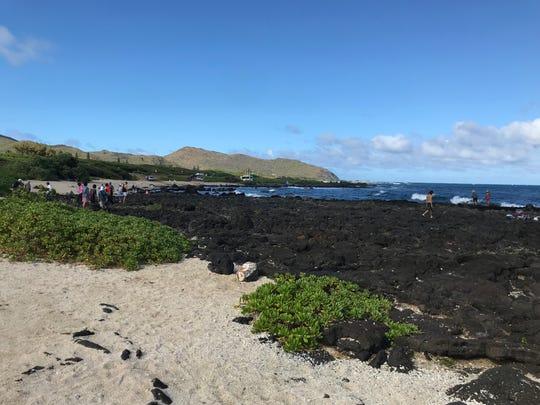 The lava rocks are a big tourist draw at Sandy Beach on Oahu.