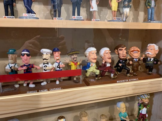 The racing sausages and racing presidents from the Brewers and Nationals are on display at the National Bobblehead Hall of Fame and Museum.