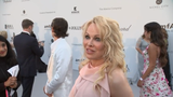 """Swedish prosecutors recently reopened an inquiry into rape allegations against Julian Assange. Pamela Anderson says she thinks the accusations are """"a setup."""" (May 24)"""