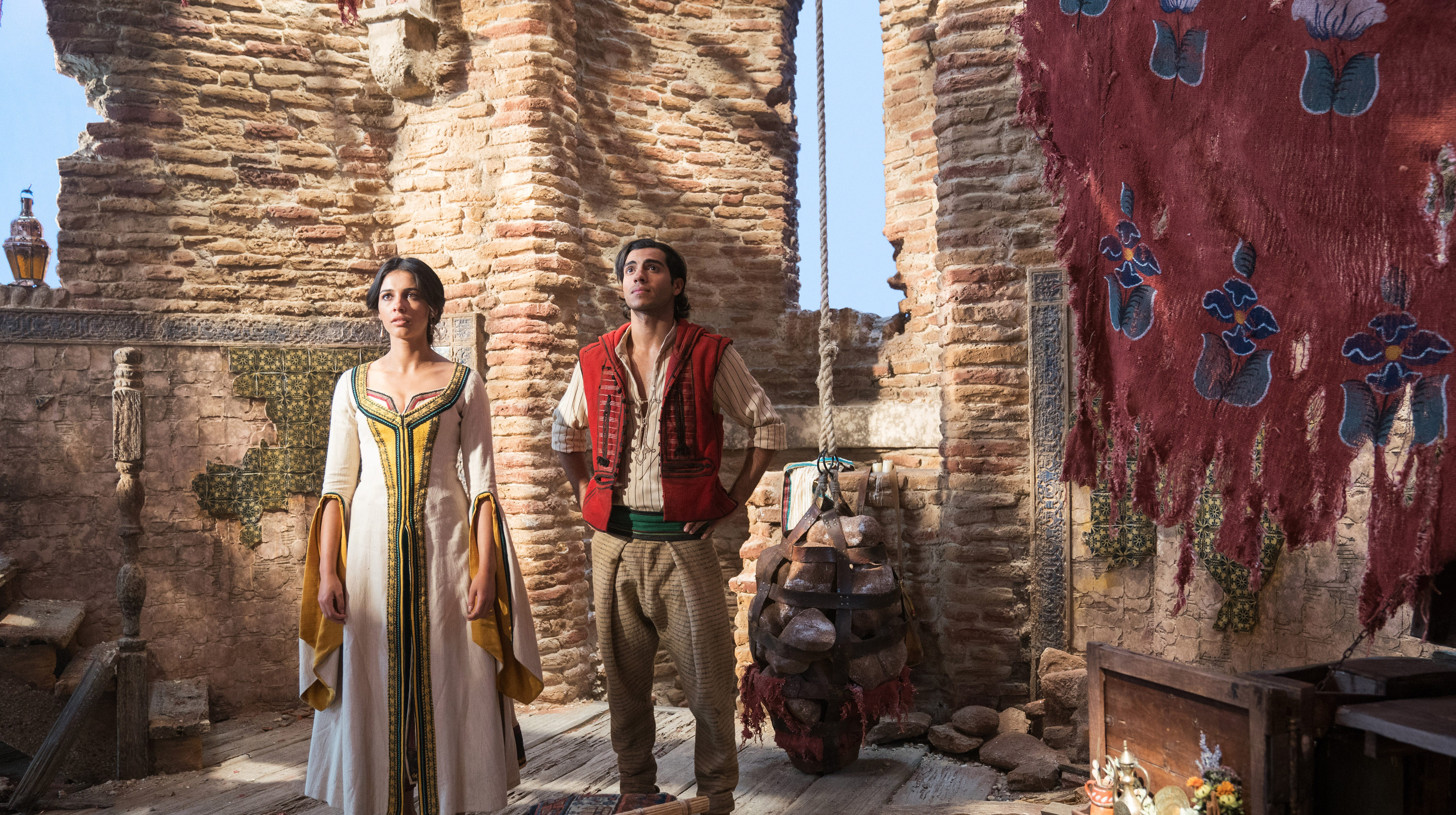 Naomi Scott is Jasmine and Mena Massoud is Aladdin in Disney's live-action ALADDIN, directed by Guy Ritchie.