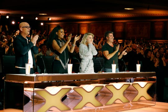"""America's Got Talent"" judges Howie Mandel, left, Gabrielle Union, Julianne Hough and Simon Cowell give a standing ovation after a Season 14 audition performance."