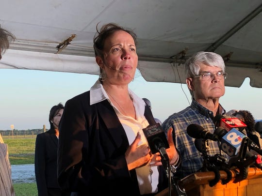 Lisa Noland, who survived an attack at the hands of serial killer Bobby Joe Long, speaks to reporters after his execution May 23, 2019, in Starke, Fla.