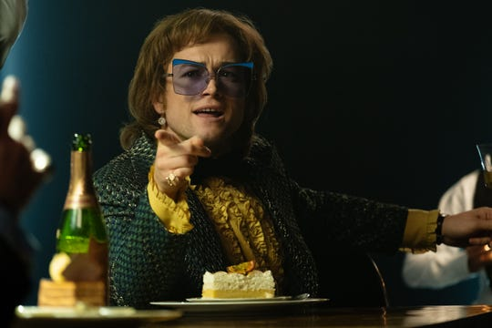 "Lavish costumes were key to Taron Egerton's transformation into ""Rocketman"" Elton John."