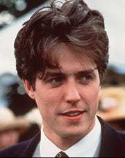 "Hugh Grant pictured with his hair in ""Four Weddings and a Funeral"""