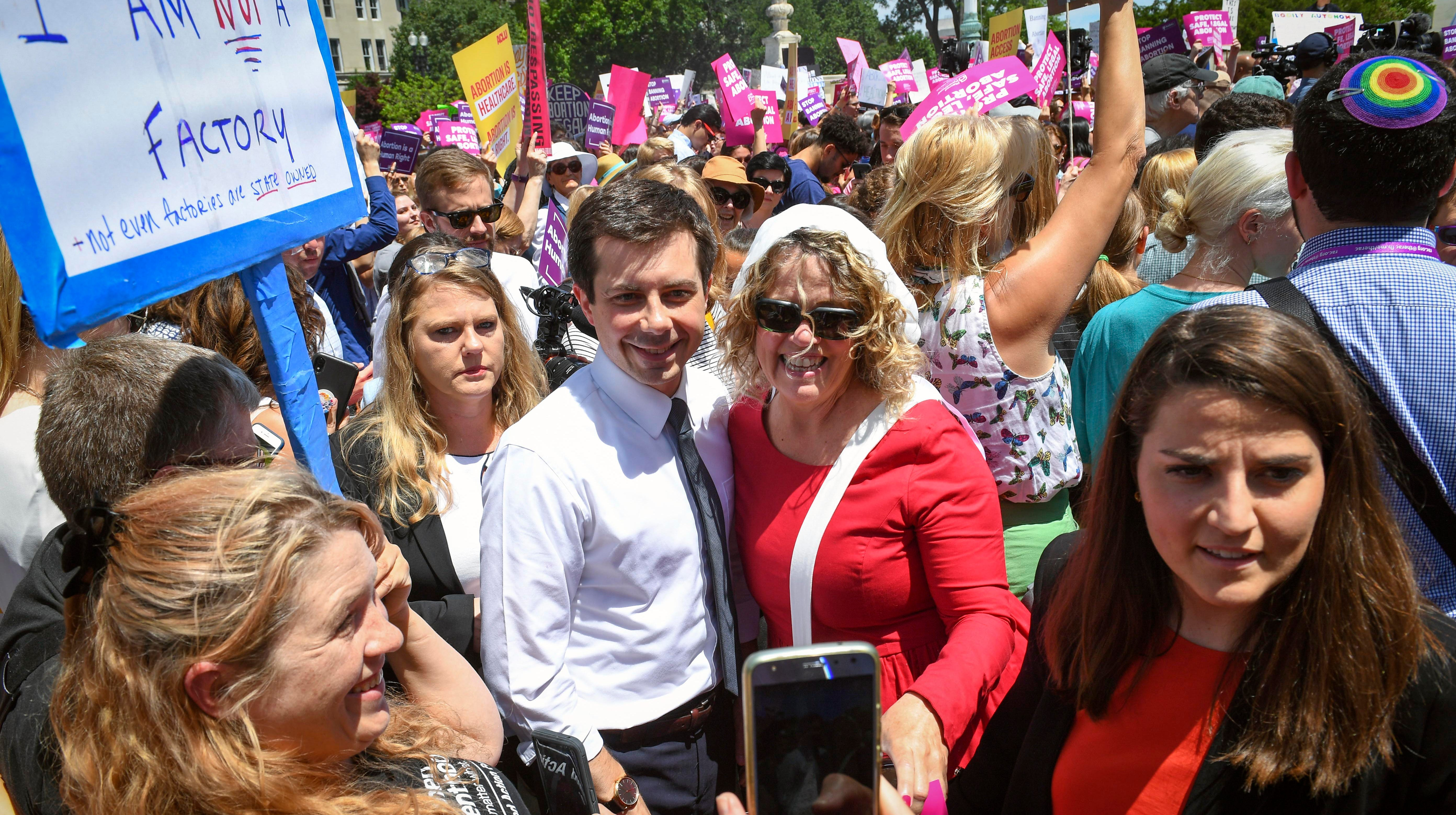 Democratic Presidential candidate Pete Buttigieg, the mayor of South Bend, Indiana, walks through protesters who rallied to stop the abortion bans in the United States on the steps of the U.S. Supreme Court in Washington on May 21, 2019.