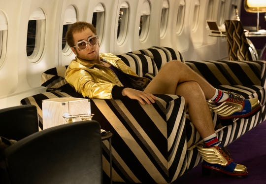 "Taron Egerton jet sets as Elton John in ""Rocketman."""