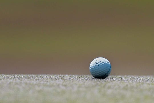 Golf ball on the 9th hole green during the final round of the Zurich Classic golf tournament.