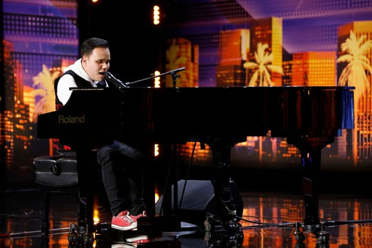 Kodi Lee plays the piano and sings during Tuesday's Season 14 premiere of NBC's 'America's Got Talent.'