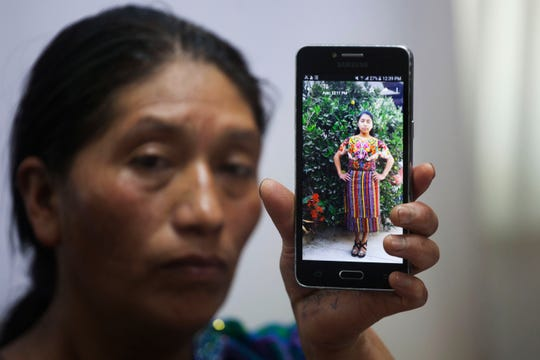 In this Friday, May 25, 2018, file photo, Dominga Vicente shows a photo of her niece, 20-year-old Claudia Patricia Gomez Gonzalez, who was allegedly killed by an agent of the U.S. Border Patrol in Nuevo Laredo, Texas, during a news conference at the National Migrants Commission headquarters in Guatemala City. Advocates for Gomez Gonzalez are demanding $100 million in damages. x