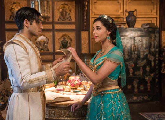"There was a rule on the ""Aladdin"" set: ""No midriff,"" producer Dan Lin says. Mena Massoud, left, plays Aladdin in the new film opposite Naomi Scott, who plays Jasmine."