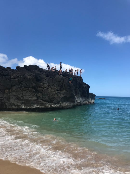 Cliff jumping is the most popular activity at Waimea Bay Beach Park on the north shore of Oahu