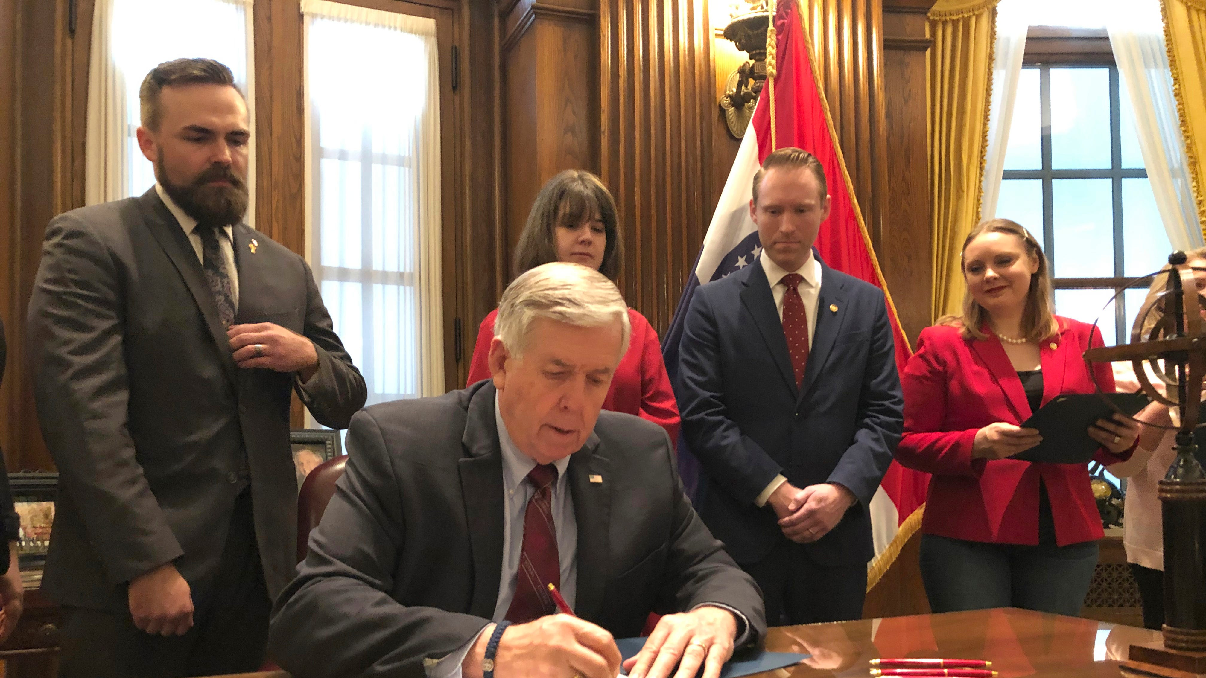 Missouri Gov. Mike Parson signs one of the nation's most restrictive abortion bills, banning the procedure on or beyond eight weeks of pregnancy.
