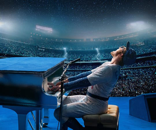 "Elton John (Taron Egerton) performs to a sold-out stadium in sparkly Dodgers wear in ""Rocketman."""