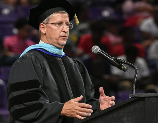 Superintendent Richard Rosenberger, Anderson School District 2, speaks during Belton-Honea Path High School graduation in Littlejohn Coliseum in Clemson Friday.