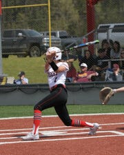 Many's Keely Dubois (1) gets a hit during a game this season. Dubois is one of two Many softball players on the LSWA Class 2A softball team.