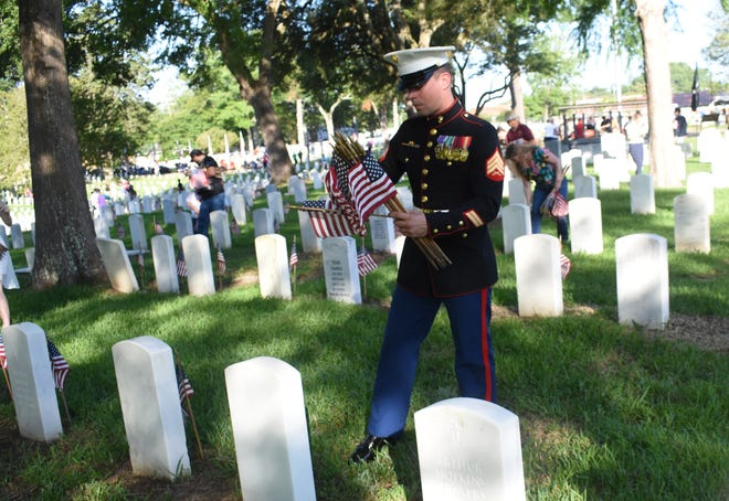Retired U.S. Marine sergeant and Iraq and Afghanistan veteran Douglas Brown of Cheneyville was among the volunteers placing flags on the 7,816 gravesites at the Alexandria National Cemetery Saturday, May 25, 2019 in preparation for the Memorial Day program set for Monday. Brown is running for state senator of District 31. Alexandria mayor Jeff Hall is the guest speaker. The cemetery is located at 209 East Shamrock Street in Pineville. The Memorial Day program begins at 9:45 a.m. Monday. A patriotic musical and reading, placing of wreaths by various Veteran service organizations, a rifle salute and the playing of taps are among the program activities. All Americans are asked to participate in a National Moment of Remembrance at 3 p.m. Monday to remember and honor military personnel who died in service to the U.S.
