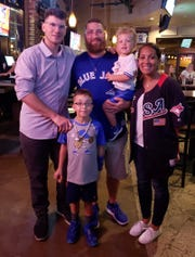 Danny Jansen (left) with brother Matt (center) and his wife Tiffany with their children Maddux and Maverick (held)