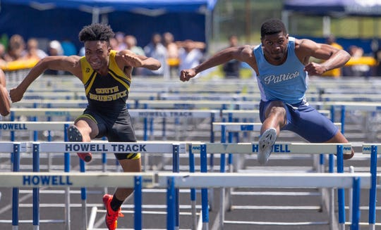 Freehold Township's Felix Lawrence (rigt) wins the Boys Central Group IV 110 Hurdles over South Brunswick's Malcolm Yarber
