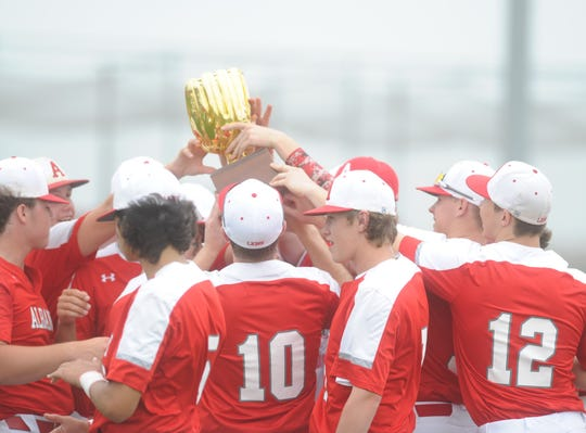 The Albany baseball team celebrates with its Region I-2A semifinal trophy following Game 2's victory over Hale Center.