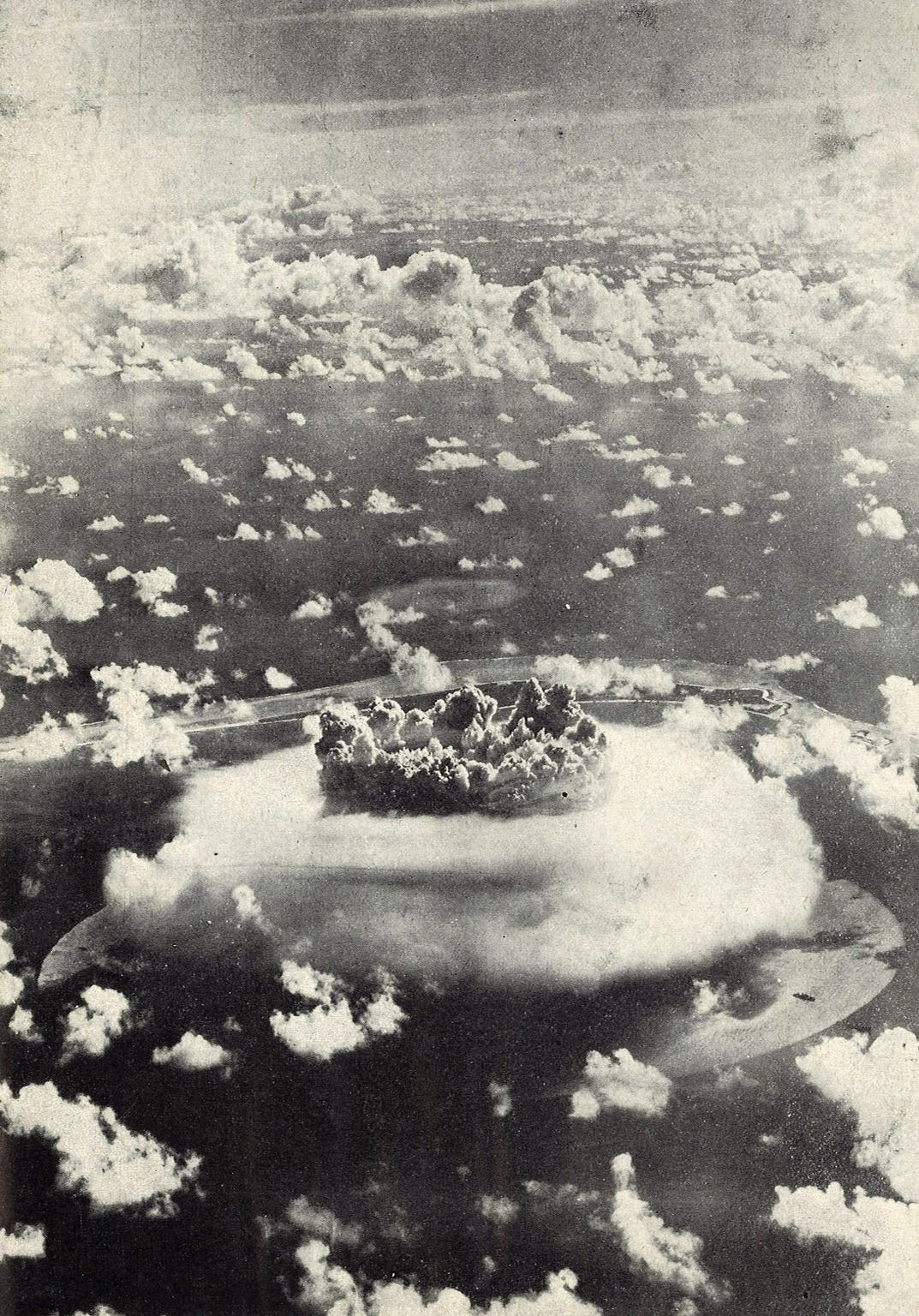 This photo of the Baker burst was made at 10,000 feet and shows its height over the Bikini Atoll. The crown of the explosion was compared to cauliflower.