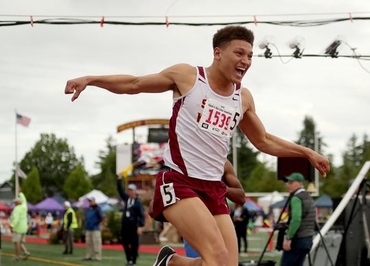 South Kitsap's Deyondre Davis leaps into the air after winning the 110-meter hurdles title at the Class 4A track and field championship at Mount Tahoma High School in May. Davis is the Kitsap Sun Male Athlete of the Year for 2019.
