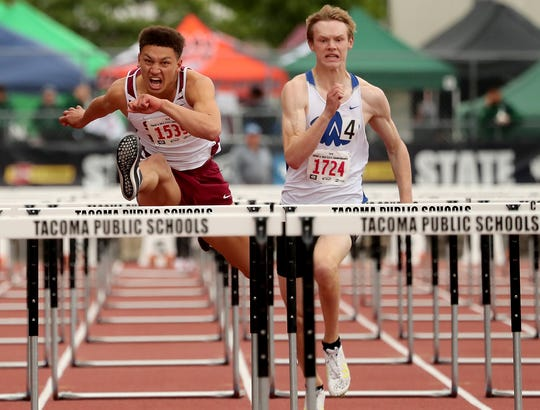 South Kitsap's Deyondre Davis, left, takes the lead in the Class 4A boys 110-meter hurdles against Walla Walla's Jared McAlvey during Friday's state track and field championships at Mount Tahoma High School.