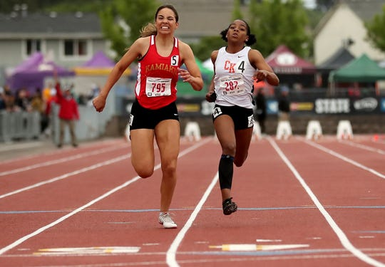Central Kitsap's Kymeal Gaulden, right) placed second in the Class 3A girls 100- and 200-meter dashes and helped the Cougars' 4x100 relay team place second at Saturday's state meet.