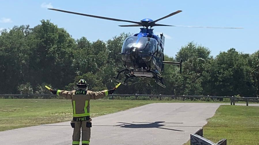 First Flight helicopter arrives at Fay Lake Wilderness Park after a female patient was bitten by an alligator.