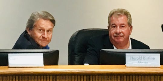 Port Canaveral Chief Executive Officer John Murray, left, and Canaveral Port Authority attorney Harold Bistline, on the dais at a recent Canaveral Port Authority meeting.