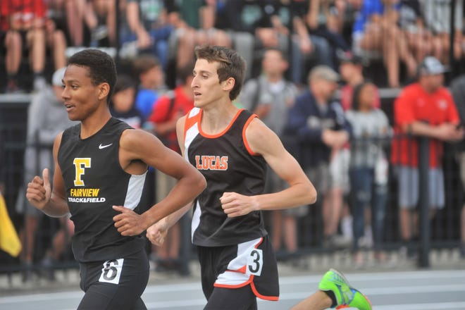 Lucas senior Gavin Shindeldecker en route to winning the 1600 at the Division III regional track and field meet in Tiffin.