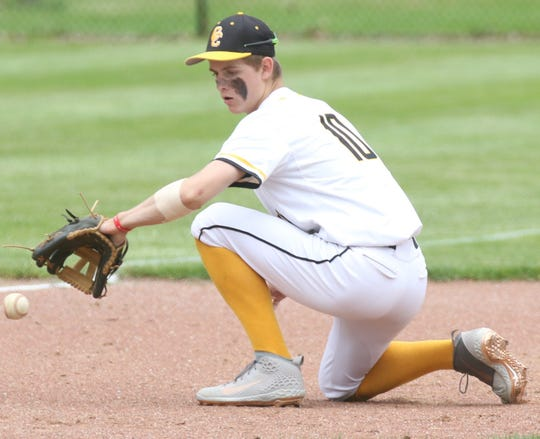 Colonel Crawford's Cade Hamilton makes a back-handed play during the Eagles 8-1 win over Mohawk in the Division IV district championship.