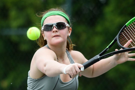 Hartford's Phelan O'Keefe hits the ball during the girls individual tennis finals at Burlington Tennis Club on Saturday May 25, 2019 in Burlington, Vermont.