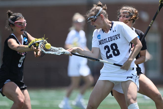 Middlebury's Casey O'Neill corrals the ball during the Division III national semifinals on Saturday. The Panthers won 16-8.