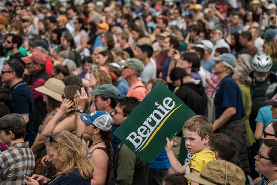About 1,500 supporters cheer as presidential candidate Bernie Sanders takes the stage a rally on the steps of the State house in Montpelier, Vt., on Saturday. May 25, 2019.