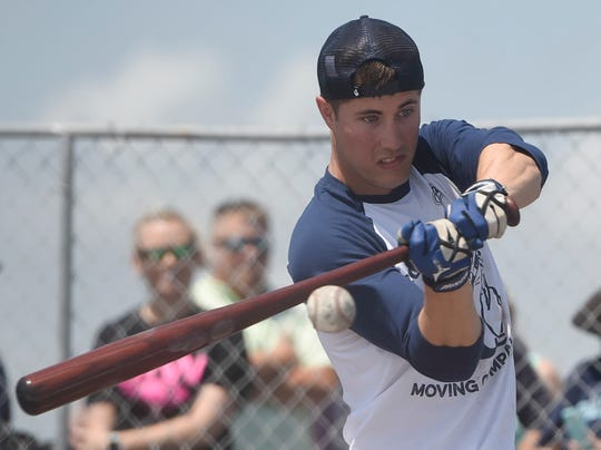 Navy flight student Sean Kamhoot hits the ball during a batting practice on the deck of the Lexington, Friday, May 24, 2019, on the USS Lexington. Kamhoot won the home run derby at Whataburger Field on May 11.