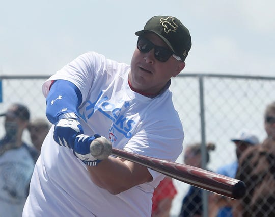 Staff sergeant Stephen Gillespie hits the ball during batting practice on the deck of the Lexington, Friday, May 24, 2019, on the USS Lexington.
