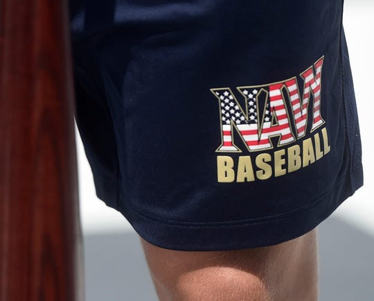 Sean Kamhoot wears Navy Baseball shorts during the  batting practice on the deck of the Lexington, Friday, May 24, 2019, on the USS Lexington. Kamhoot was a pitcher at the Naval Academy.