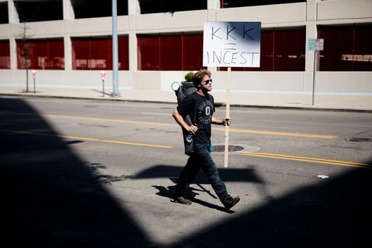 Chad Dean, of Enon, Ohio, carries a sign while protesting the Honorable Sacred Knights rally outside the Montgomery Courthouse Square in Dayton, Ohio, on Saturday, May 25, 2019. The Honorable Sacred Knights, a Klu Klux Klan affiliated group, received permit to hold a rally from 1 p.m. until 3 p.m. in Downtown Dayton.