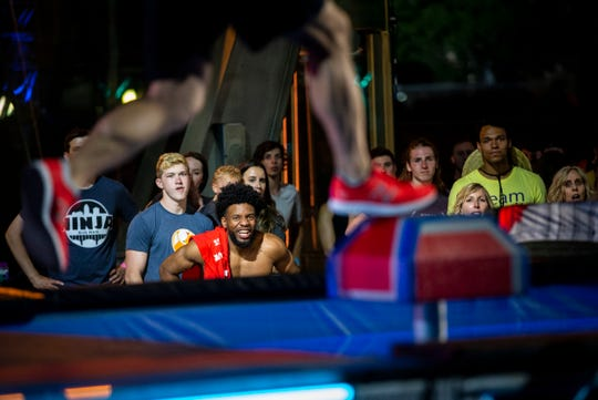 "Fans cheer on Jimmy Choi as he jumps on to the shrinking steps on ""American Ninja Warrior"" in downtown Cincinnati Friday, May 24, 2019."