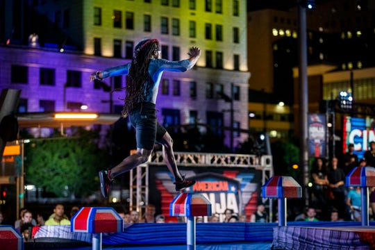 "James Wilson, the Nati Ninja, jumps on to the shrinking steps, which is the first obstacle on ""American Ninja Warrior,"" Friday, May 24, 2019 in downtown Cincinnati."