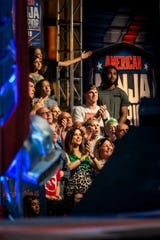 "Fans, including Cincinnati Bengals quarterback Andy Dalton, watch Drew Lachey compete on ""American Ninja Warrior"" in downtown Cincinnati Friday, May 24, 2019."