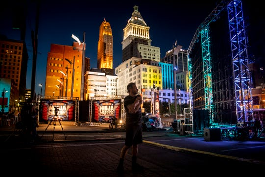 "Drew Lachey stretches behind the stage of ""American Ninja Warrior,"" as he prepares to compete in downtown Cincinnati Friday, May 24, 2019."
