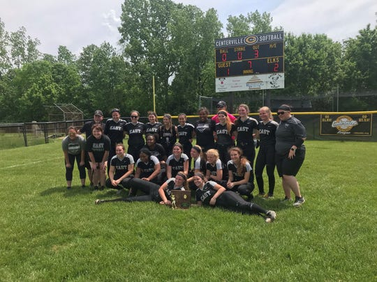 The Lakota East softball team poses in front of the scoreboard after beating Lakota West, 2-1, for a regional championship Saturday afternoon at Centerville High School. The Thunderhawks advance to the state Final Four for the first time since 2010.