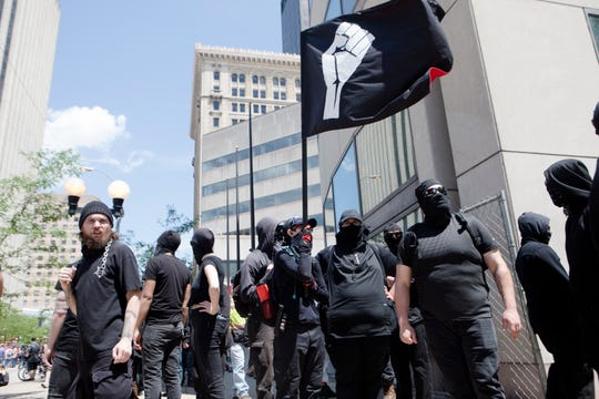 Members of ANTIFA gather while protesting the Honorable Sacred Knights rally outside the Montgomery Courthouse Square in Dayton, Ohio, on Saturday, May 25, 2019. The Honorable Sacred Knights, a Klu Klux Klan affiliated group, received permit to hold a rally from 1 p.m. until 3 p.m. in Downtown Dayton.