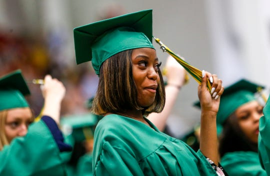 Students turn over their tassel in the ceremonial move to signify having graduated while hundreds of Northwest High School students were accepted as graduates and walked the stage to receive diplomas while being cheered on by loved ones at the Winfield Dunn Center in Clarksville, Tenn., on Saturday, May 25, 2019.