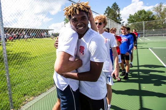 Cedar Rapids Washington senior Rami Scheetz embraces soccer teammate Keaton Woods, right, after winning during the Class 2A boys' tennis singles state championship, Saturday, May 25, 2019, at Veteran's Memorial Tennis Center in Cedar Rapids, Iowa.