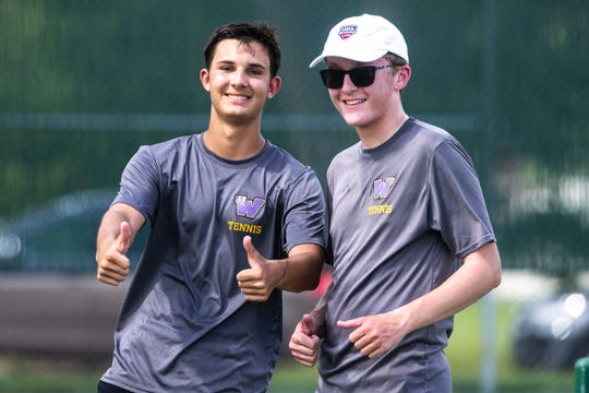 Waukee senior Noah Burmeister, left, and sophomore Will Ecklund pose for a photo during the Class 2A boys' tennis state doubles championship, Saturday, May 25, 2019, at Veteran's Memorial Tennis Center in Cedar Rapids.