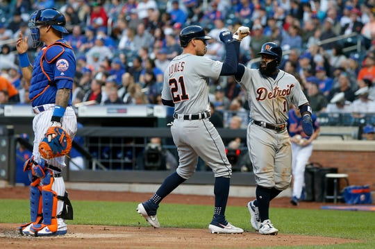 Tigers' JaCoby Jones celebrates his second-inning two-run home run with Josh Harrison at Citi Field on Friday.