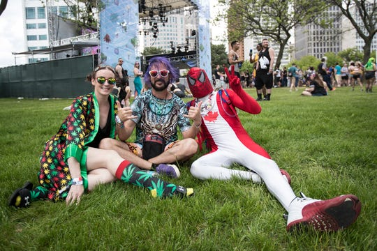 From left, Connie Anderson of Windsor, ON, Larry Lenning of Evansville, Ind., and Thomas Whittaker of Windsor, ON, pose for a photo during Movement Music Festival at Hart Plaza in Detroit, Saturday, May 25, 2019.